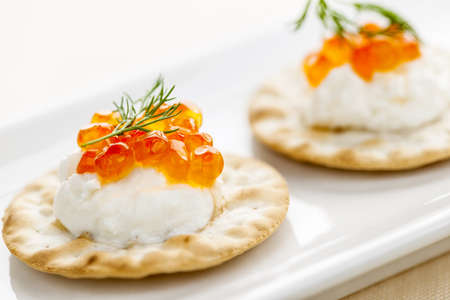 Closeup of caviar and cream cheese appetizer on crackers Stock Photo - 18341629