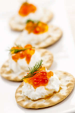 Closeup of caviar and cream cheese appetizer on crackers Stock Photo - 18341597