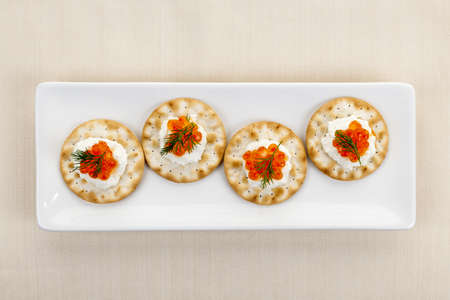 Caviar appetizer with goat cheese and crackers on white plate from above Stock Photo - 18341760