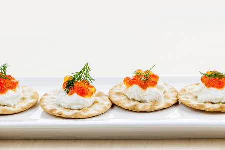 Caviar appetizer with goat cheese and crackers on white plate Stock Photo - 18341601