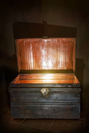 Antique wooden chest with open lid and light inside Stock Photo - 18341777