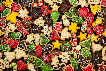 Cooling rack with freshly baked homemade shortbread Christmas cookies over wooden background from above Stock Photo - 18341810
