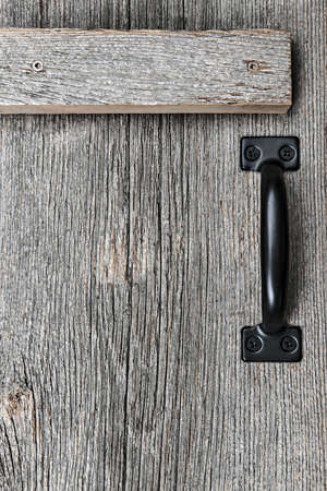 Distressed rustic barn wood door with handle as textured background Stock Photo - 18341821