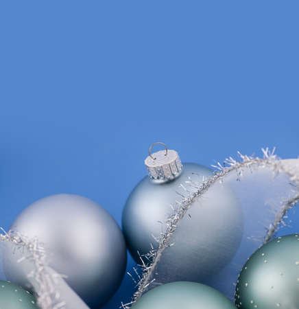 Glass Christmas balls with holiday ribbon on blue background Stock Photo - 18654195