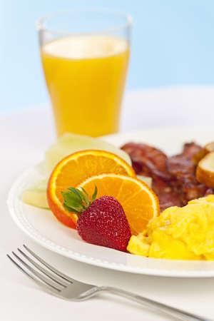 Healthy breakfast of scrambled eggs bacon fruit and orange juice Stock Photo - 19014566