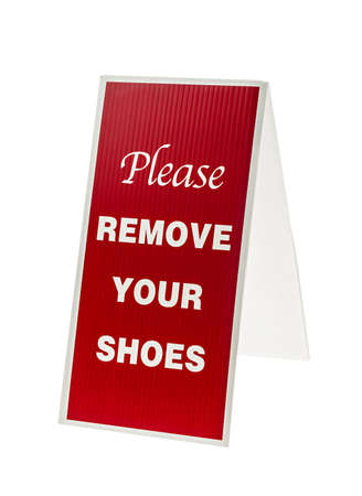 Red and white sign saying Please Remove Your Shoes isolated