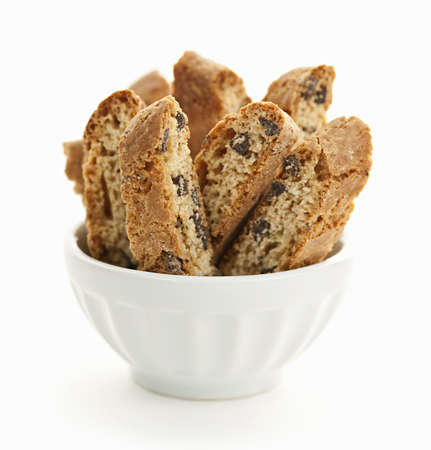 Italian chocolate chip biscotti in bowl isolated on white background Stock Photo - 19382505