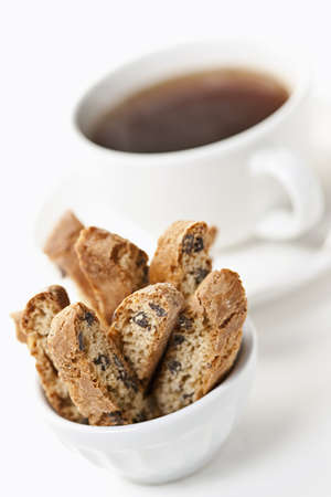 Italian biscotti in a bowl with cup of black coffee on white background Stock Photo - 19382476