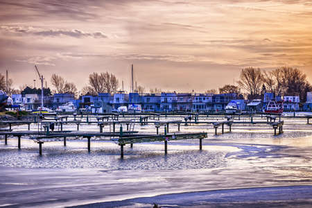 Sunset behind floating homes at Bluffers park marina in Toronto, Canada.  Winter. Stock Photo - 19382543