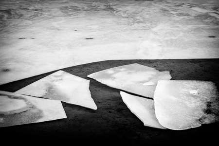 Black and white image of broken ice pieces in dark water Stock Photo - 19382546