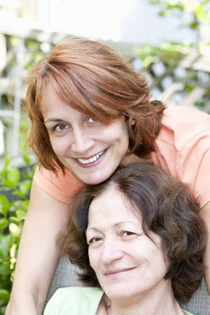 Family portrait of smiling mature mother and daughter Stock Photo - 19535944
