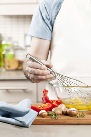 Closeup on man's hands whisking eggs in bowl for cooking omelet with vegetables Stock Photo - 19535946