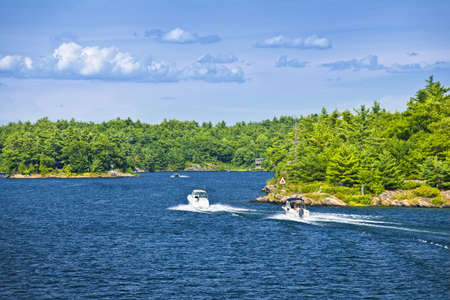Recreational boats on blue waters of Georgian Bay near Parry Sound, Ontario Canada Stock Photo