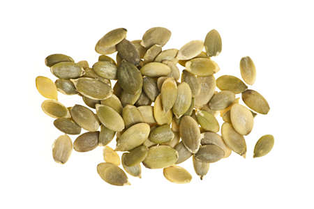 heaping: Heap of raw pumpkin seeds isolated on white background