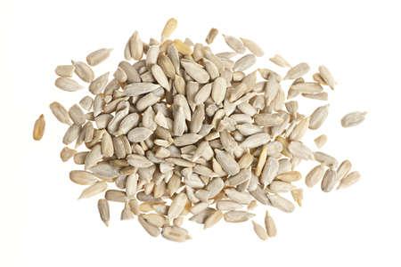 semillas de girasol: Montón de semillas de girasol peladas crudas aislados sobre fondo blanco desde arriba Foto de archivo