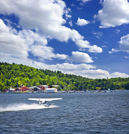 sound off: Seaplane taking off from Georgian Bay at Parry Sound Ontario Canada Stock Photo