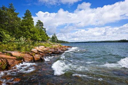 Rocky lake shore of Georgian Bay in Killbear provincial park near Parry Sound, Ontario, Canada.