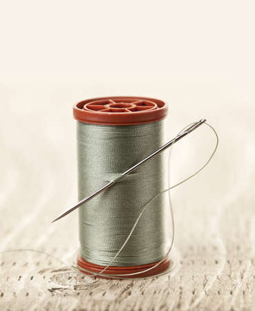 Spool of thread with needle for sewing Stock Photo