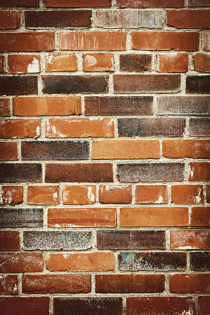 Red and brown brick background of grungy wall