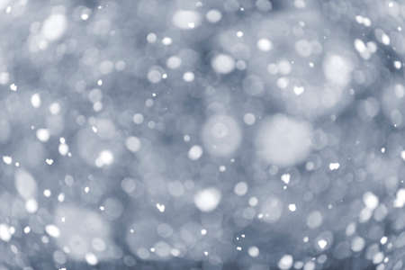 Background of snow flurry falling in winter with some motion blur Stock Photo