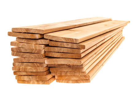 Stacks of cedar one by six inch wood planks on white background Stockfoto