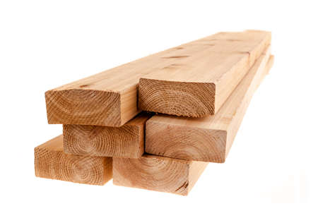 Edge of six cedar two by four wood boards on white background Imagens
