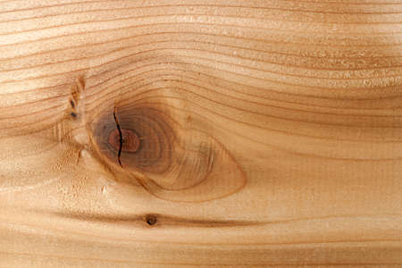 Closeup of red cedar plank showing knot texture and natural woodgrain pattern as wood background Reklamní fotografie - 29611453