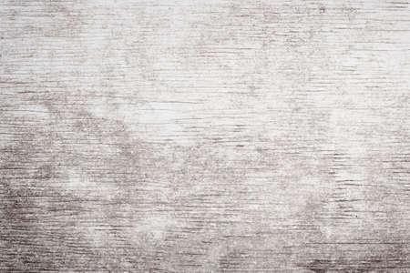 Grijze houten achtergrond van verweerde noodlijdende rustieke hout met vervaagde witte verf tonen houtnerf structuur