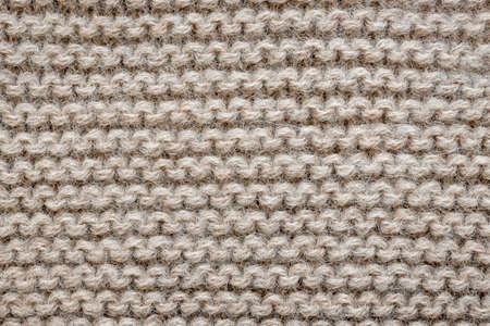 Knit texture of undyed natural brown alpaca wool knitted fabric with garter stitch pattern as background Фото со стока - 31485894