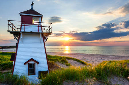 Beautiful sunset at Covehead Harbour lighthouse, Prince Edward Island, Canada Zdjęcie Seryjne - 31485903