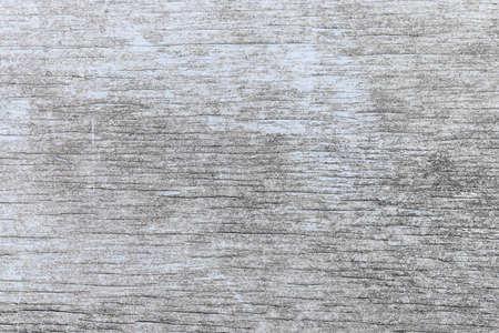 木目調テクスチャを表示色あせた光ブルー ペイントで風化の苦しめられた素朴な木の古い木製の背景 写真素材