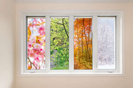 Window in home interior with view of four seasons Stockfoto