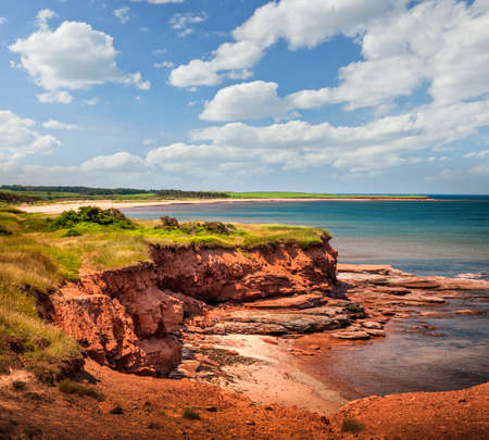 Red cliffs of Prince Edward Island Atlantic coast at East Point, PEI, Canada.