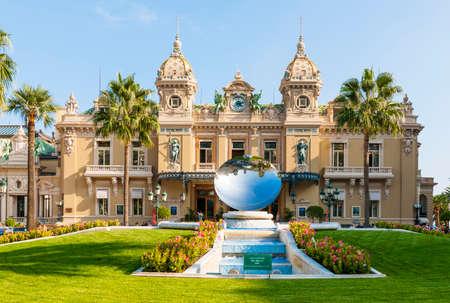MONTE CARLO, MONACO - OCTOBER 3, 2014: Facade of Monte Carlo Casino in Monaco with Sky Mirror sculpture by Anish Kapoor in front Editorial