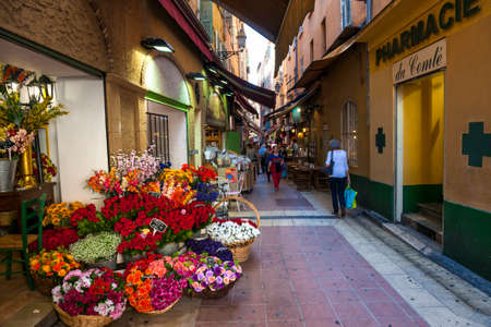 NICE, FRANCE - OCTOBER 2, 2014: Walking pedestrian Rue Pairoliere, a quaint shopping street lined with food shops and cafes, is a great way to experience authentic Nice. Editorial