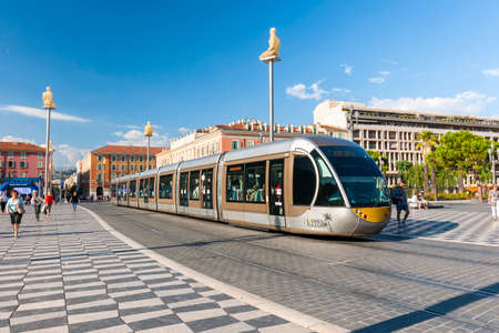 NICE, FRANCE - OCTOBER 2, 2014: Nice tramway at Place Massena, the main pedestrian square of the city. The cars of the tramway are unique and have been designed to blend with surrounding architecture and art.