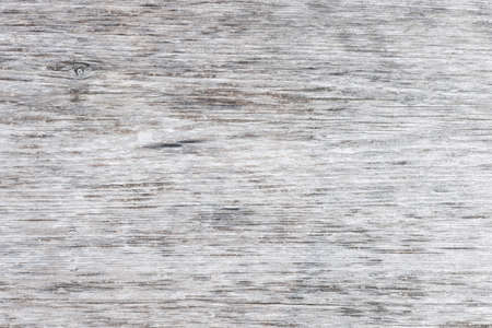 Gray wooden background of weathered distressed unpainted rustic wood showing woodgrain texture