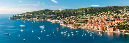 Panoramic aerial view of French Riviera coast at Villefranche-sur-Mer harbour and Cap de Nice with leisure boats anchored at Mediterranean sea 版權商用圖片