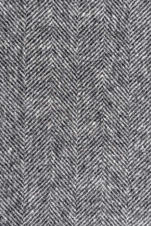 Visgraat tweed achtergrond met close-up op wollen stof textuur Stockfoto