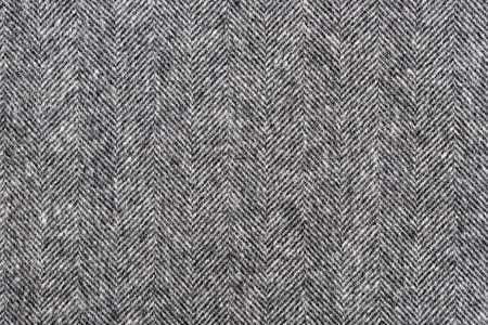 Herringbone tweed background with closeup on wool fabric texture