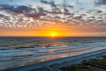 Sunrise over Atlantic ocean with dramatic sky in Florida, aerial view. 版權商用圖片