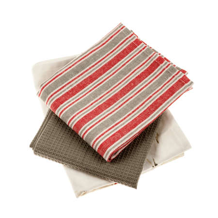 Set of kitchen towels in natural colors isolated on white background