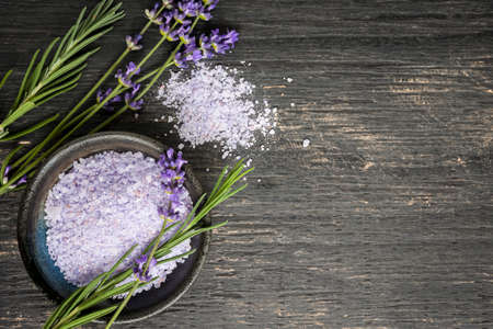 Bath salts herbal body care product with fresh lavender on rustic wooden background, copy space Stockfoto
