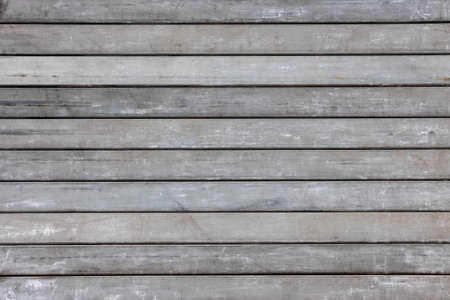 Gray weathered boards background of old wooden planks