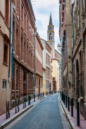 Narrow street  in old center of Toulouse, France.