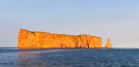 Perce Rock or Rocher Perc� view from Gaspe Peninsula at sunset  in Quebec, Canada.