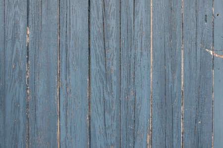 Rustic background of weathered wooden boards with wood texture painted blue