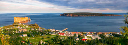 Panoramic view of Perce Rock and Bonaventure Island from Mount Sainte-Anne lookout point  in Perce, Gaspe peninsula, Quebec, Canada.
