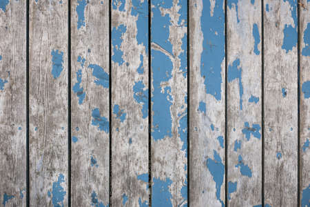Rustieke achtergrond van verweerde houten planken met sporen van oude blauwe verf Stockfoto