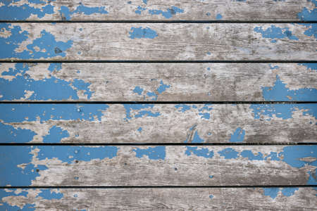 Rustic background of weathered wooden boards with traces of old blue paint Standard-Bild